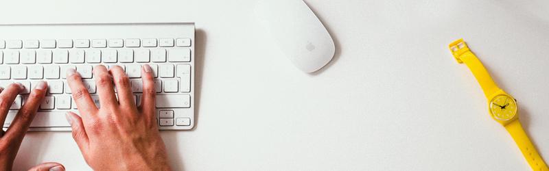 Hands writing on a keypad.